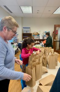 Assembling lunch bags for the Lowell Transitional Living Center